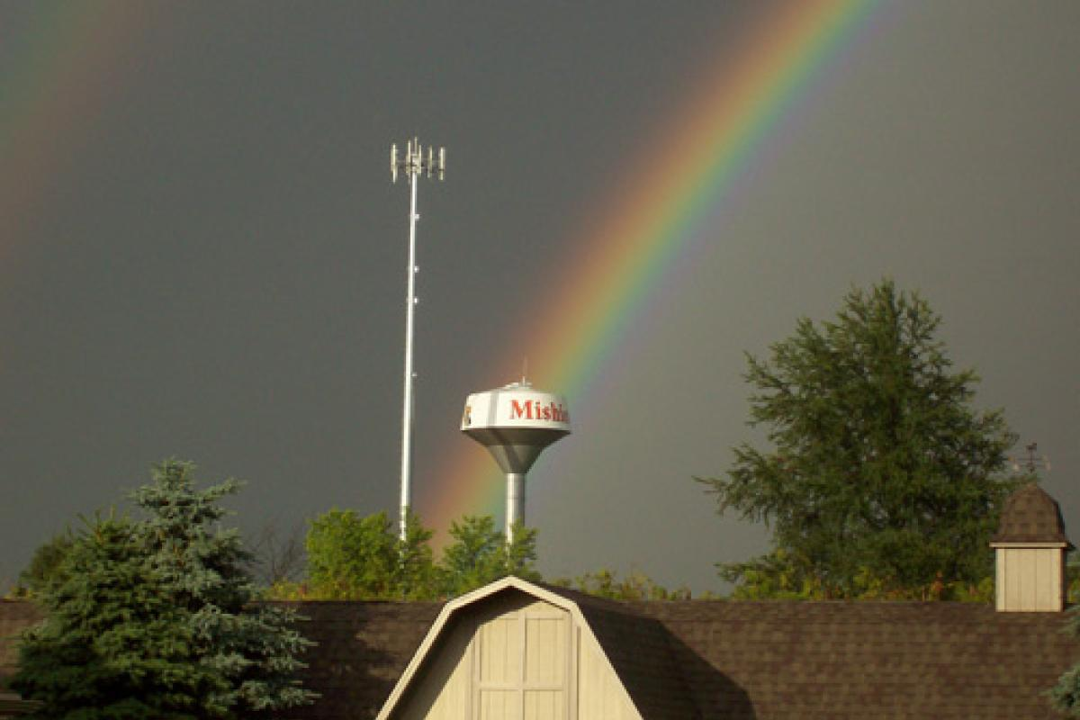 Rainbow over a water tower